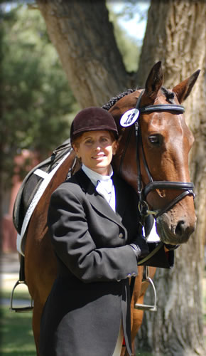portrait of a dressage rider with her horse